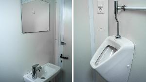 RECO's mobiele toiletunit met 2 toiletten, een urinoir en waterbesparende kranen